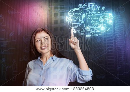Stay Smart. Cheerful Attractive Woman Expressing Joy While Thinking About Her Ideas