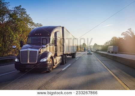 18 Wheeler Semi Truck On Highway With Sun Lens Flare