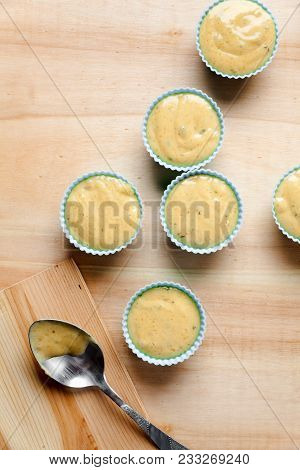 Silicone Bakeware Filled Muffin Batter On Wooden Background