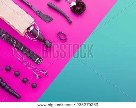 Different Sex Toys Are On The Background In The Color-block Style (fuchsia And Green). The Wand Mass