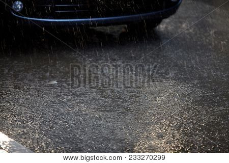 Heavy Rain Drops On Road While Raining.