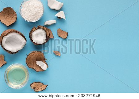 Plate With Coconut Gluten Free Flour, Water And Nuts On Blue Background, Top View, Copy Space. Organ