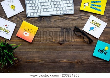 Work In Social Media. Media Marketing. Desk With Keyboard And Socail Media Icons. Dark Wooden Backgr