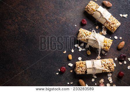 Granola Bars. Fruit And Grain Granola Bars On Dark Stone Table. Top View Copy Space.