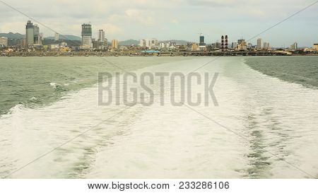 Waves On The Water From The Movement Of The Ferry. Departure Of Tourists. Panorama Of The City Of Ce