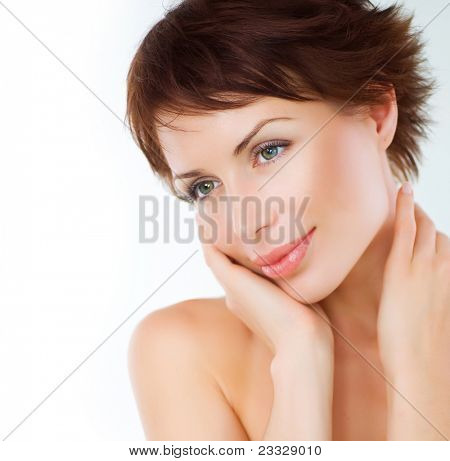 Beautiful Young Woman touching her Face. Skincare .Perfect Skin