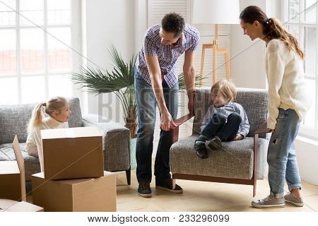 Happy Young Family With Small Kids Having Fun Together Playing On Moving Day In New Home Concept, Fa