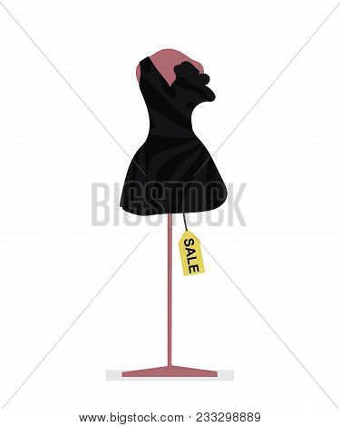 Black Short Female Dress On A Pink Mannequin And Tag Sale Isolated On A White Background