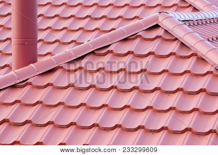 Roof is covered with metal tile roof with a Chimney.