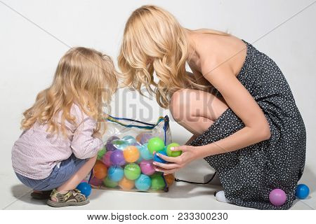Mother And Son, Happiness. Happy Family Play With Toy Balls. Mother And Child, Relatives. Mothers Da