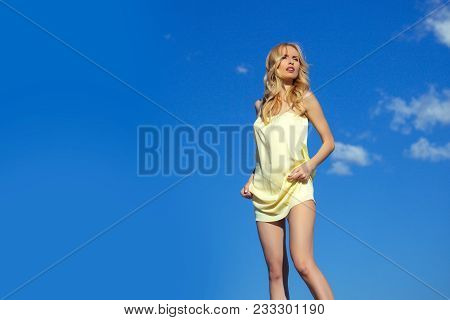 Freedom And Expectation. Girl With Sexy Legs, Loneliness. Woman In Summer On Blue Sky Background. Be