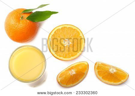 Orange Juice With Sliced Orange And Green Leaf Isolated On White Background. Top View With Copy Spac