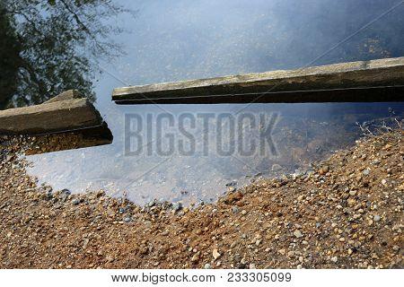 Damaged Pond Edge Boards
