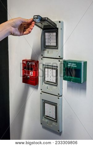 Hand Open Electric Box Switch Near The Push In Pull Down Switch In Case Of Fire And Emergency Door R