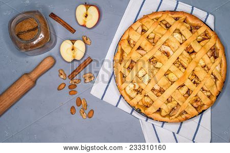 Apple Pie On A Gray Kitchen Towel, With Apples, Cinnamon, Sugar And Nuts, Top View