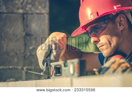 Caucasian Masonry Worker In Hard Hat. Construction Site Theme.