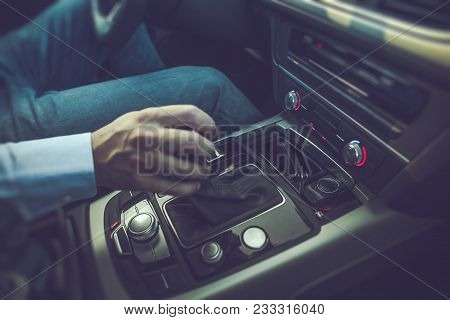 Caucasian Men Driving The Car. Shifting Automatic Transmission To Drive Position.