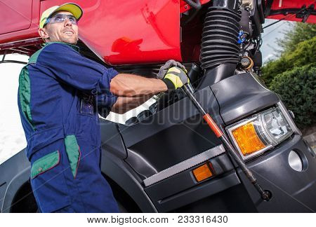 Semi Truck Maintenance By Professional Truck Mechanic. Caucasian Technician Preparing Truck Cabin Fo