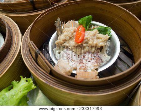 Yumcha Or Dimsum, Mantis Shrimp And Pork Steamed Dumpling In Bamboo Basket Steamer In Chinese Restau