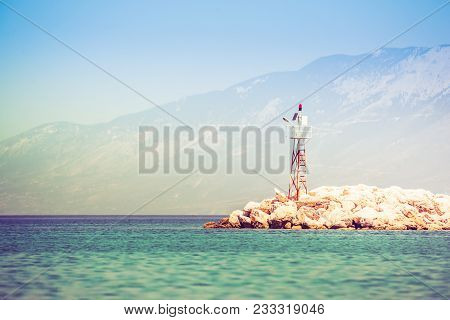 Rocky Sea Shore With Beacon. Horizontal Orientation Photo.