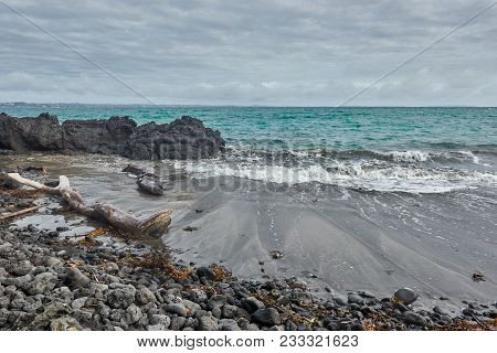 Waves On The Beach At Mckenzie Bay In Rangitoto Island New Zealand