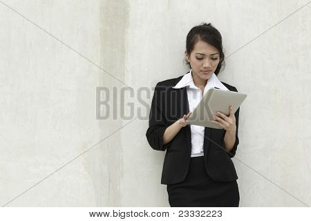 Asian Businesswoman using a Touch-pad PC
