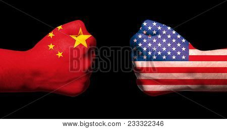 Flags Of Usa And China On Two Clenched Fists Facing Each Other On Black Background/usa China Trade W