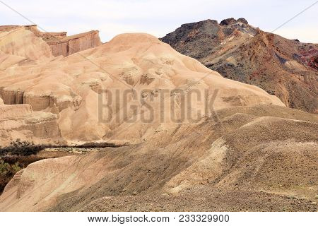 Eroded Mountains With Dried Up Mud Creating A Badlands Landscape Taken In Death Valley National Park
