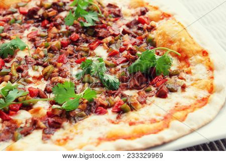 Meat pizza with hot sauce, Asian style, toned image
