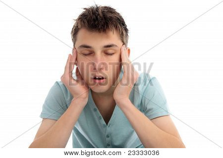 A boy rubbing temples with a headache migrain or maybe stressed. poster