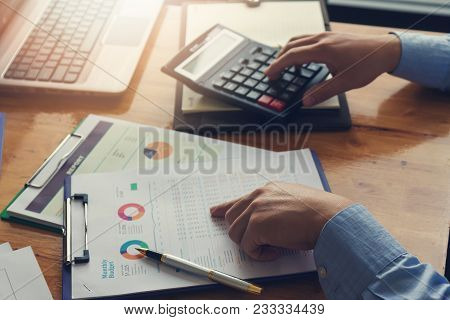 Business And Finance Concept Of Office Working, Businessman Using Calculator To Discussing Sale Anal
