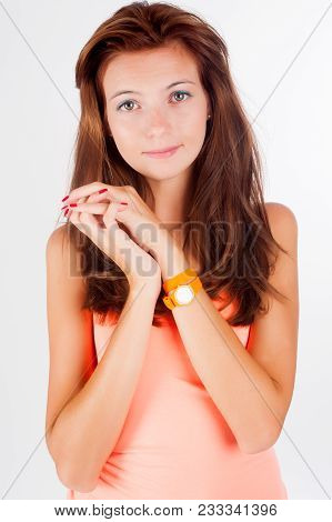 Attractive Red-haired Girl With Freckles Wearing Pink Dress Over White Background