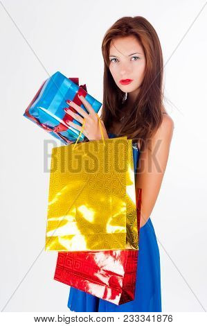 Beautiful Shopping Red-haired Woman With Freckles Holds Bags, Isolated Over White Studio Background.