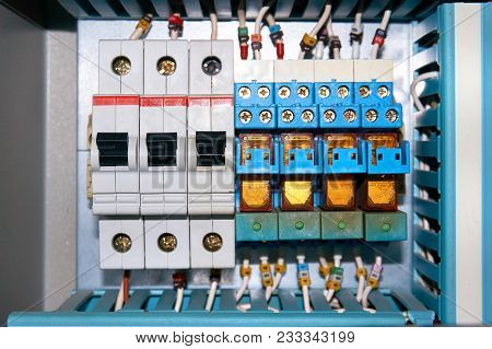 Electrical circuit breakers and electrical relays with connected wires. poster