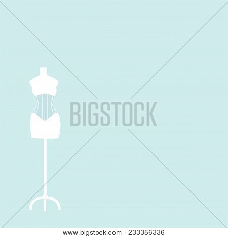 Light Mannequin With Corset On A Light Blue Background.