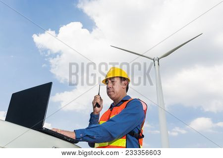 Architect Or Engineer Use Laptop Computer And Transceiver Handheld Radio To Communicate With Headqua
