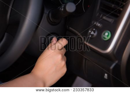 Close-up Portrat Of Woman Hand Inserting Key To Turn On/off Car Engine.
