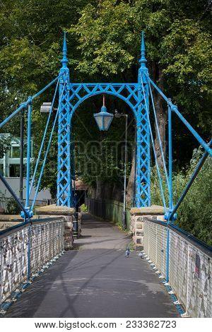 Beautiful Ironwork Footbridge Over The River Leam At Jephson Gardens, Leamington Spa, Warwickshire,
