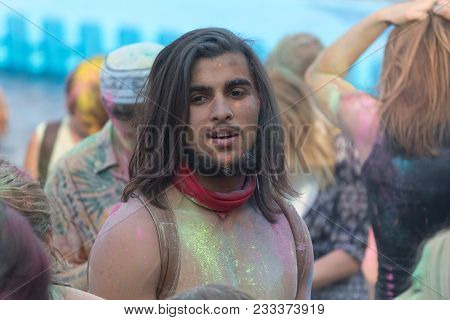 Kiev, Ukraine - August 06, 2017: Man Is Stained With Paint During The Holi Festival At The Festival