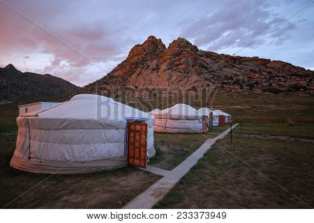 Typical Mongolian Landscape And Steppe With  Yurts