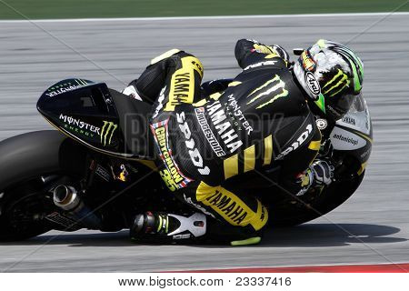 SEPANG, MALAYSIA - FEBRUARY 2: MotoGP rider Cal Crutchlow of the Monster Yamaha Tech 3 Team practices at the 2011 MotoGP winter tests at the Sepang International Circuit. February 2, 2011 in Malaysia