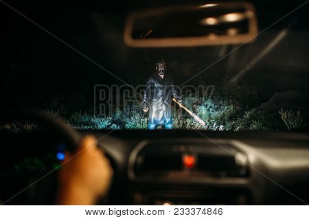 Serial maniac standing in the way of victim on car