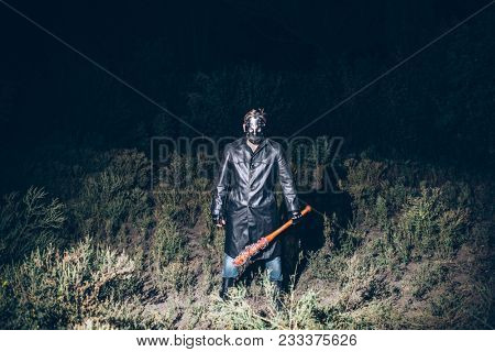 Serial maniac in hockey mask with baseball bat