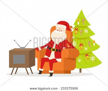 Sitting Santa Claus In Orange Big Armchair Near Tv Set And Decorated Christmas Tree On On White Back