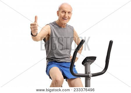 poster of Senior exercising on a stationary bike and making a thumb up sign isolated on white background