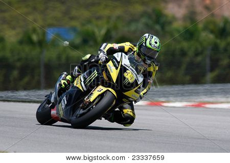 SEPANG, MALAYSIA - FEBRUARY 22: MotoGP rider Cal Crutchlow of Monster Yamaha Tech 3 team practices at the 2011 MotoGP winter tests at the Sepang International Circuit. February 22, 2011 in Malaysia.