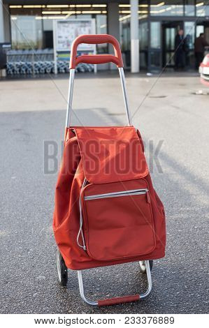 Shopping Cart With Bag Outside Of A Supermarket.