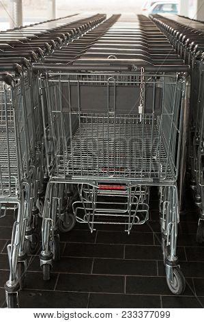 Several Shopping Carts Outside At A Supermarket.