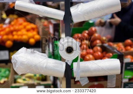 White Plastic Bags In A Supermarket Stand.