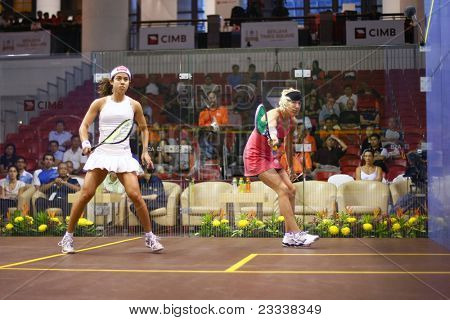 KUALA LUMPUR, MALAYSIA - MARCH 18: World #1 Nicol David (white) plays Kasey Brown (Australia) at the quarterfinals of the CIMB KL Open Championship 2011 on March 18, 2011 in Kuala Lumpur, Malaysia.